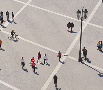 An areal view of people walking in a paved area
